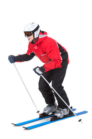 Young man in ski suit is jumping with skis on white background.