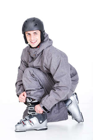 Skier prepares for skiing, isolated on a  white background. photo