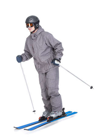 Portrait of a skier in a ski suit and with skis isolated on white background. photo