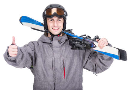 Portrait of a skier in a ski suit and with skis isolated on white . photo
