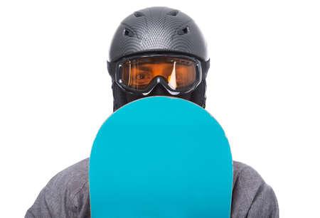 boy jumping: Retrato de hombre joven en ropa de deportes con el snowboard aislado en un blanco.