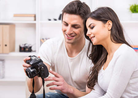 Young couple are using pc tablet to looking at photographs. photo