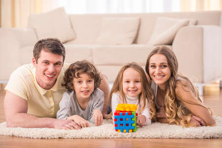 family portrait: Happy to be a family. Portrait of happy family with kids in living room. Stock Photo