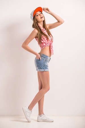 stylish girl: Young stylish girl in casual clothes over gray background.