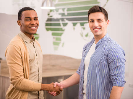 handshakes: Handshakes of two international business men in casual clothes.