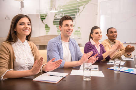 Cheerful business people applauding in a meeting. Business concept. Stock Photo
