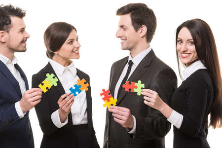 wanting: Image of business people wanting to put pieces of puzzle together.