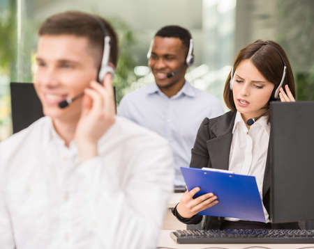 Call centre agents talking on the headset in the office.