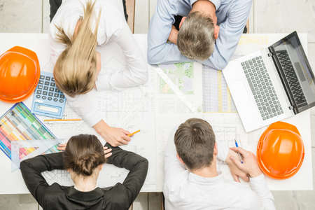 Overworked designer team sleeps at workplace in office. Reklamní fotografie