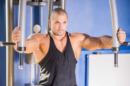 heavy weight: Male bodybuilder doing heavy weight exercise for chest.