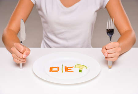 Healthy eating, vegetarian food, dieting. Concept of diet. Plate with vegetables. Stock Photo