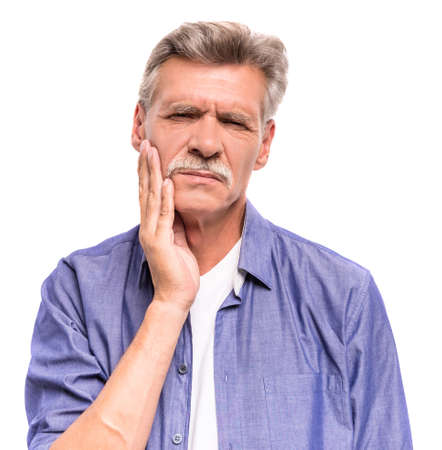dent douleur: Senior man is suffering from tooth pain.
