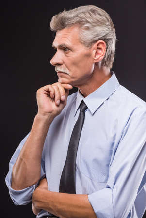 handsome: Side view of senior man is thinking about something. Stock Photo