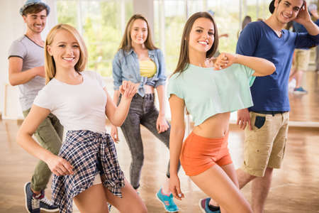 ballet hombres: Young dancing people in gym during exercise dancer workout training with happy fresh energy.