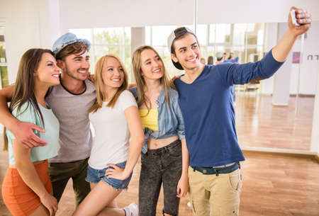 zumba: Group of people are making selfie photo in gym or dance studio.