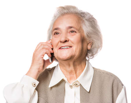 Senior woman using phone isolated on a white background