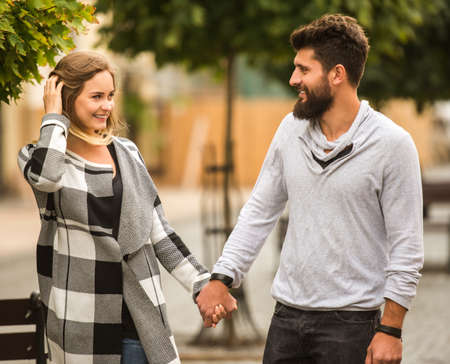 walk in: Young happy couple on a walk in the city Stock Photo