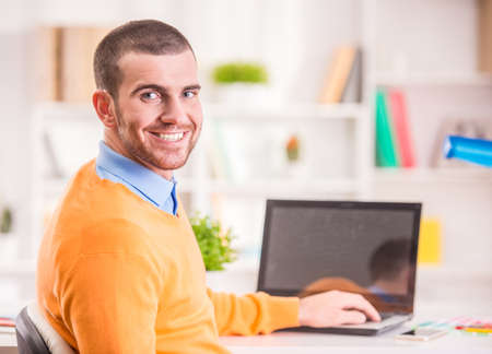 Portrait of a young businessman designer working in office
