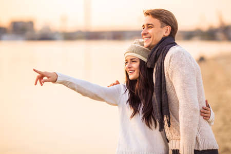 couple winter: Loving young couple walk on the beach in autumn Stock Photo