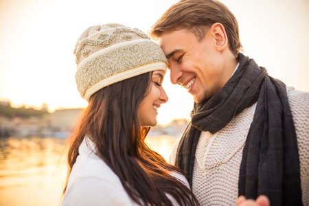 blue romance: Loving young couple walk on the beach in autumn Stock Photo