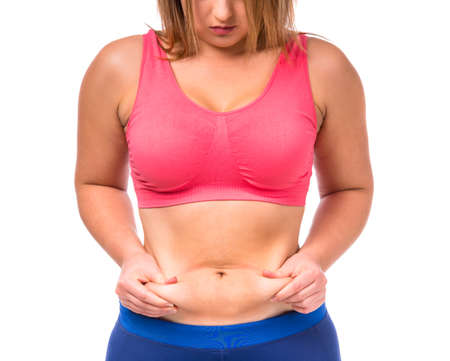 The fat woman unhappy with her body isolated on white background
