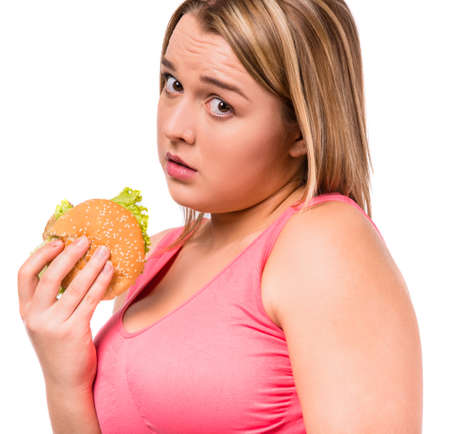The concept of healthy eating. Fat woman dieting isolated on a white background