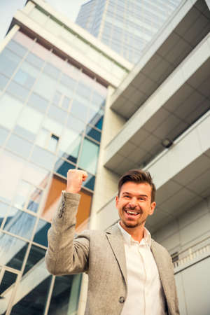 young executive: Portrait of a young successful businessman on background of office center Stock Photo