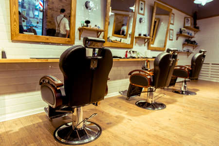 Stylish barber shop. Designed with white brick and wood. Take care of your hairstyle here!
