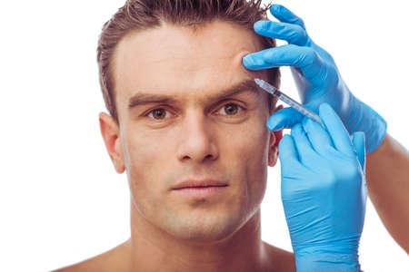 medical man: Portrait of handsome man having injections