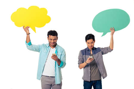 chinese american: Handsome young Afro American and Chinese with speech bubbles are using phones and smiling, isolated on white background