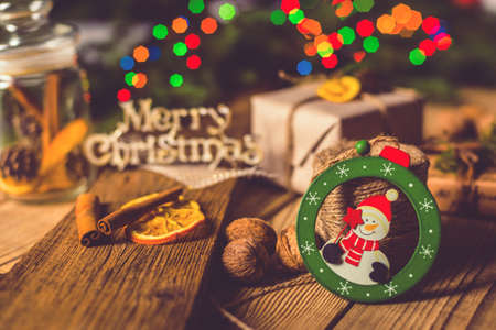 Merry Christmas! Accessories for celebrating Christmas on a wooden table