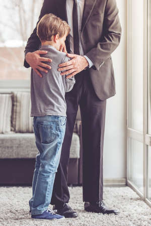 room to let: Little boy is crying while his father is hugging him