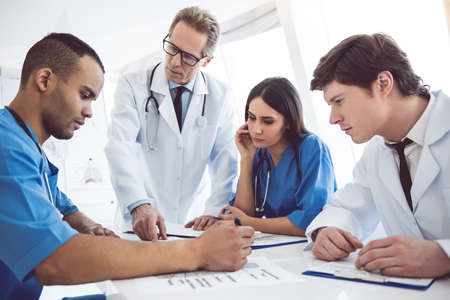 Successful medical doctors are discussing diagnosis during the conference