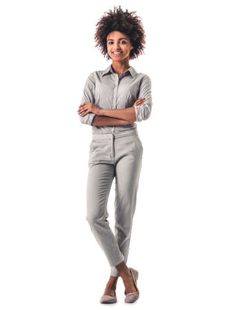 Full length portrait of beautiful young Afro American woman in smart casual wear smiling, isolated on white