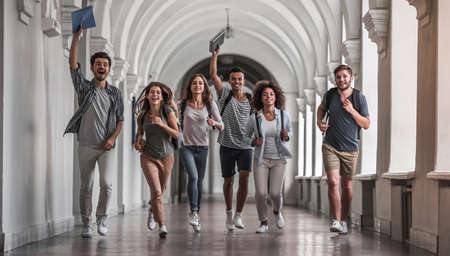 Beautiful young students are looking at camera and smiling while running through the university hall