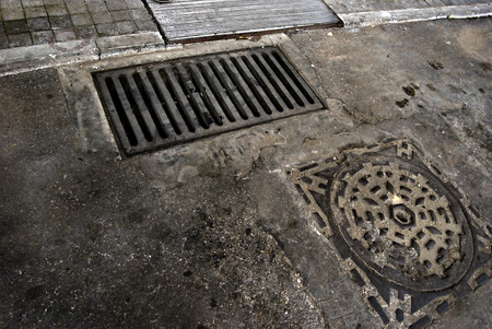 Rusty and grungy manhole covers of different shapes. 스톡 콘텐츠