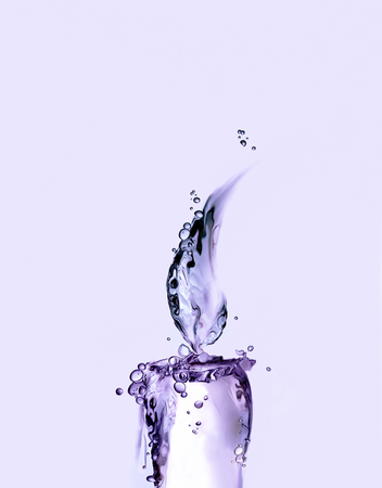 A lighted violet water candle for relaxation.