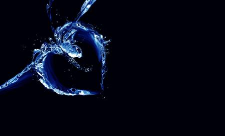 A heart made of blue liquid on black. Stok Fotoğraf