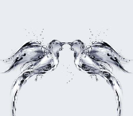 Two birds made of water kissing. 스톡 콘텐츠