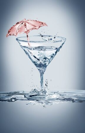 A glass of martini made of water with a red umbrella inside.