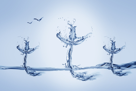 Three crosses made of water with flying birds. Archivio Fotografico