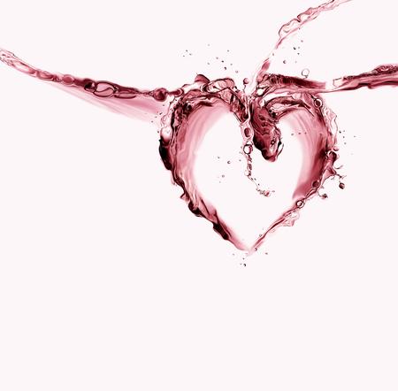 A heart made of red liquid splashing.