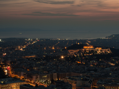 Athens cityscape with Acropolis at sunset