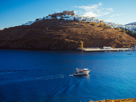 A small boat entering the old harbor of Astypalaia island