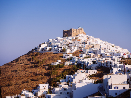 Chora of Astypapaia island ,Greece at daytime with the white houses that encircle the castle Stock Photo