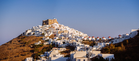 Chora of Astypapaia island ,Greece at daytime with the white houses that encircle the castle Editorial