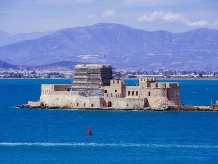 The historical water castle of Bourtzi in the middle of the old harbour of Nafplio