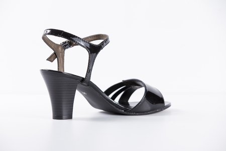 Female Black Sandal on White Background, Isolated Product, Top View, Studio. Stock Photo