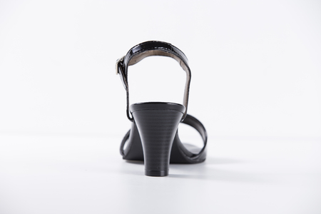 ankle strap: Female Black Sandal on White Background, Isolated Product, Top View, Studio. Stock Photo