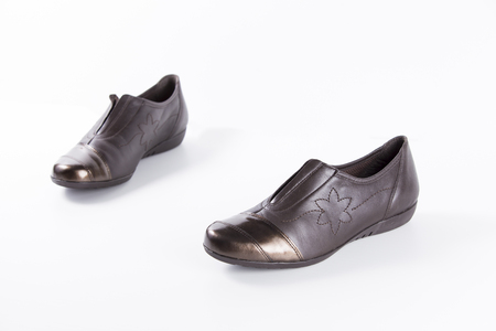 Female Brown Shoe on White Background, Isolated Product, Top View, Studio.